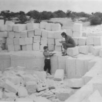 Cutting coquina blocks from a quarry